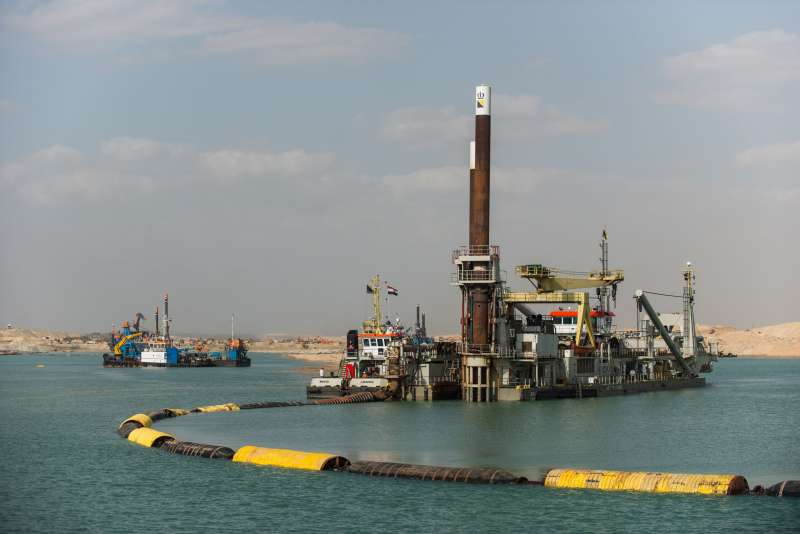 Digging machines work on the construction site of the New Suez Canal, in Ismailia, a city by the Suez Canal in Egypt