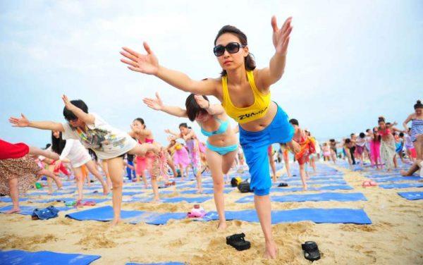 Yoga enthusiasts practising yoga