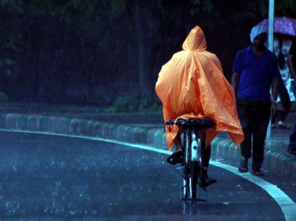 MONSOON IN INDIA: A cyclists in New Delhi