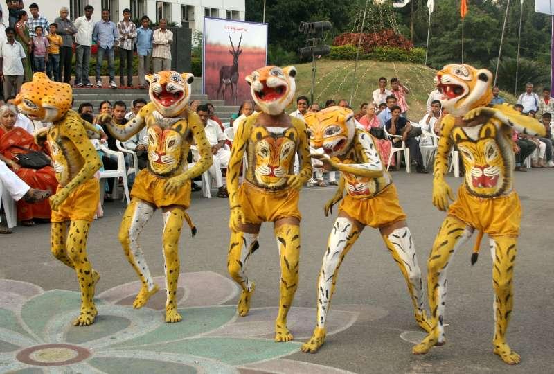 Revelers perform Pulikali at Thrissur as part of Onam festival in Kerala
