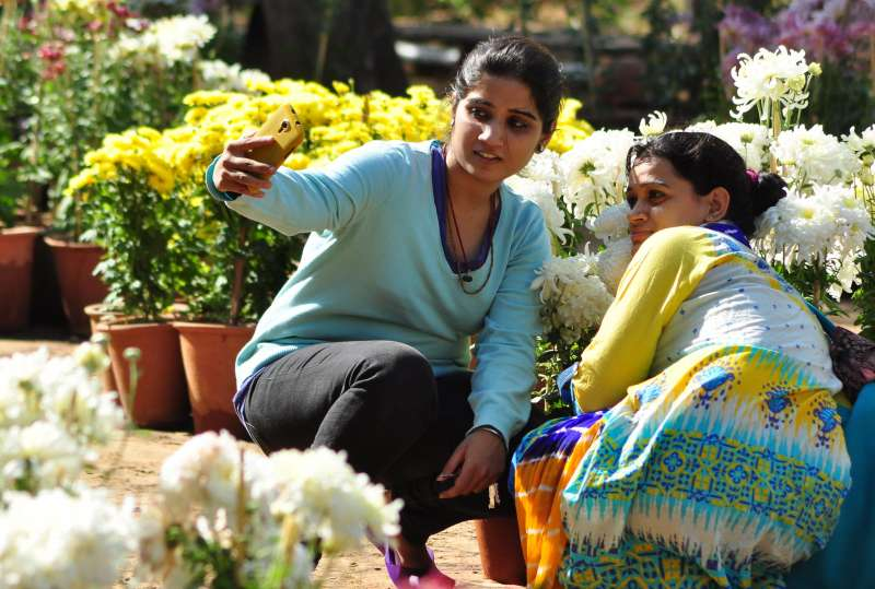 GARDEN SELFIE: Teenagers taking a selfie at a garden in Jaipur
