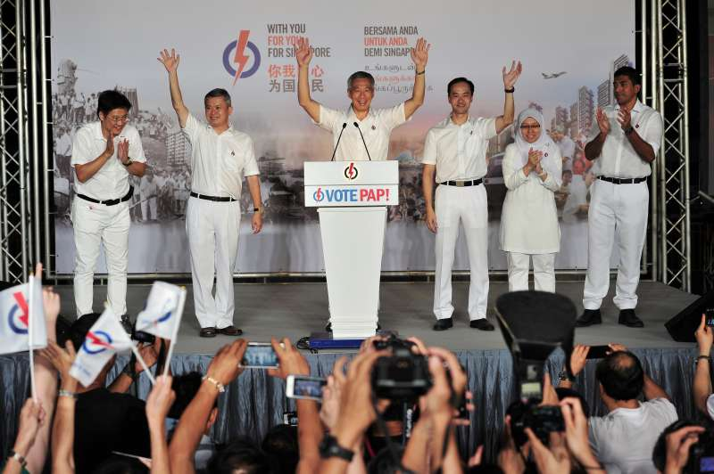 Singapore's Prime Minister and People's Action Party (PAP) Secretary-General Lee Hsien Loong (3rd L) and his team celebrate his victory with supporters in Singapore's Toa Payoh Stadium