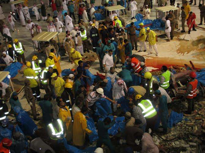 Saudi emergency teams gather inside the Grand Mosque of Saudi Arabia's holy Muslim city of Mecca after a construction crane crashed into it, on Sept. 11, 2015. 87 pilgrims were killed and 201 others were injured when a crane fell on the grand mosque in Mecca, Saudi Arabia's Civil Defence authority said Friday. Al Arabiya Television earlier said the crane had fallen because of strong storms. Saudi Arabia has been hit by strong sand storms in the last few days