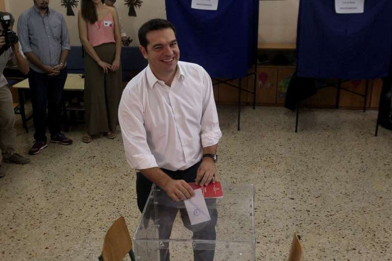 Leader of the Radical Left SYRIZA party and former Prime Minister Alexis Tsipras casts his vote at a polling station in Athens, capital of Greece, on Sept. 20, 2015. Greek voters started casting their ballots Sunday in the second general elections this year to elect a new government that will implement the latest three year bailout agreed in the summer with international creditors