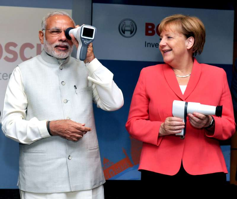 Modi and the German Chancellor, Dr. Angela Merkel at the Robert Bosch Engineering & Innovation Centre, in Bengaluru