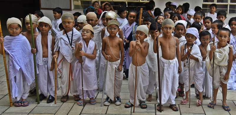 Students disguise as Mahatama Gandhi during a programme organised in a Nagpur school on the eve of Gandhi Jayanti