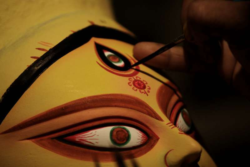 An artist busy making Durga idol at a Delhi workshop ahead of Navratri in New Delhi