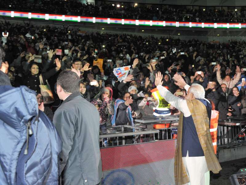 Modi greets the people after delivering his address, at Wembley Stadium, in London