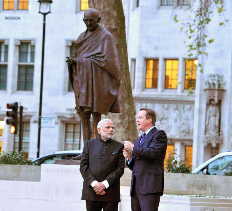 Modi and Cameron at the statue of Mahatma Gandhi, outside the UK Parliament, in Westminster, London
