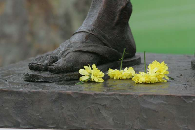 Flowers at the statue of Mahatma Gandhi at Westminster