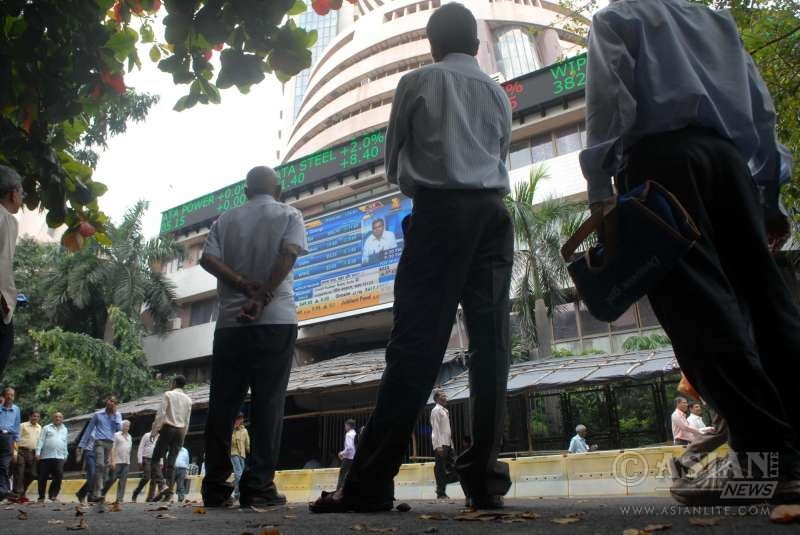 Investors react as Sensex - a benchmark index of Indian equities markets plunged 855 points or three percent-plus in Tuesday's trade session, in Mumbai on Jan 6, 2015.Market analysts opined that the fall in Indian markets was due to heavy corrections in crude oil prices and investor concerns over a potential Greek exit of the Eurozone.The Sensex touched a high of 27,698.93 points and a low of 26,937.06 points during intra-day trade.