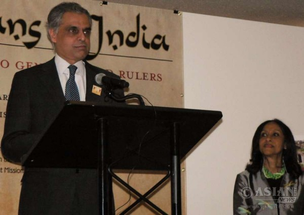 India's Permanent Representative Syed Akbaruddin speaks at the opening of the Africa in India Exhibition at the United Nations. Sylviane Diouf, the curator of the exhibition, is at right.