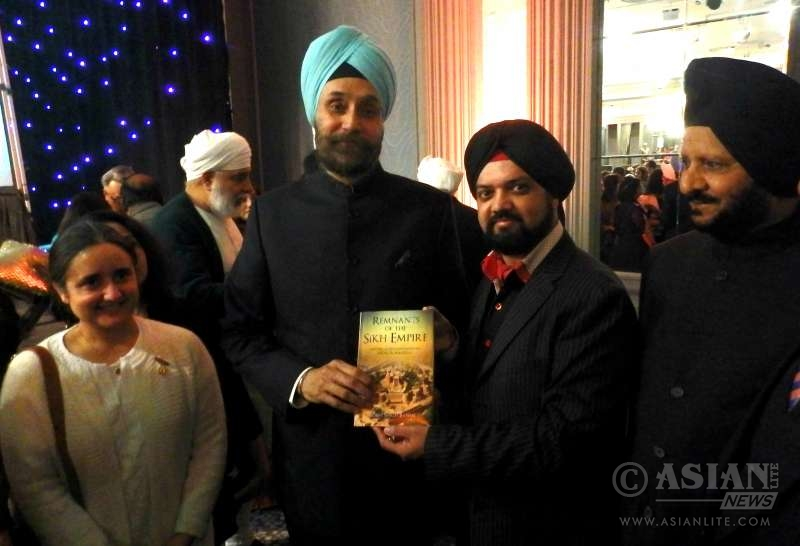Bobby Singh presents his book to High Comm