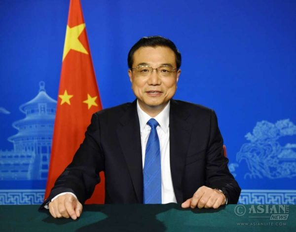 Chinese Premier Li Keqiang speaks in a video message to the G20 Finance Ministers and Central Bank Governors Meeting that opened in Shanghai, east China