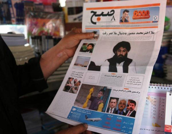 An Afghan man reads the news of Taliban leader's death on a local news paper in Kabul, capital of Afghanistan, May 23, 2016. Taliban leader Mullah Akhtar Mansoor had been targeted by U.S. military drone inside Pakistani town of Dalbandin in the southern Balochistan province on Saturday and a day later on Sunday, Afghan National Directorate of Security (NDS) or the country's spy agency confirmed Mansoor's death, saying Mansoor was killed in the strike.