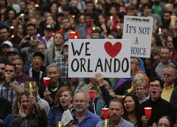 People hold candles to pay tribute to Orlando nightclub shooting victims in Vancouver, Canada, June 12, 2016. At least 50 people were killed and 53 others wounded, including a police officer, early Sunday in the shooting at the popular gay nightclub Pulse in Orlando, Florida, the United States