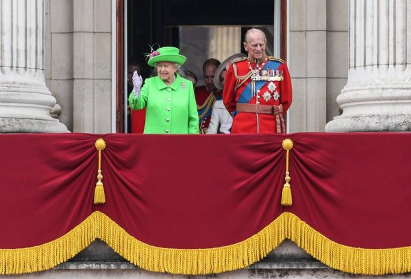 Britain's Queen Elizabeth II and her husband Prince Philip view the fly-past on the balcony of Buckingham Palace during the Queen's 90th birthday celebrations in London, Britain