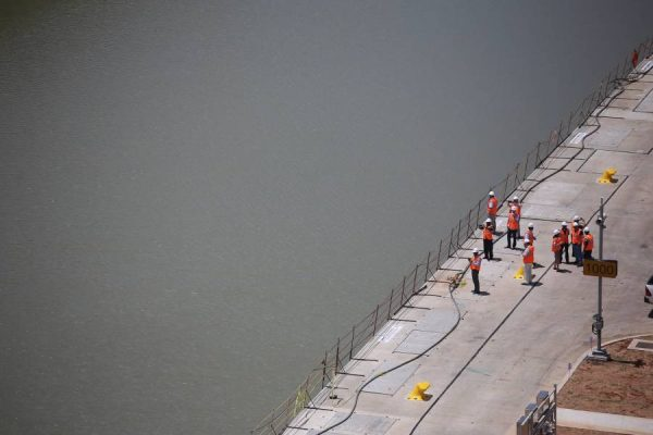 Workers walk on the platform of the expanded Panama Canal project in the Pacific sector, in Panama City, capital of Panama, on May 11, 2016. China COSCO Shipping line's container vessel Andronikos won the draw to inaugurate the Expanded Panama Canal this June, according to the Panama Canal Authority (ACP).