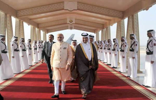 Modi being received on his arrival, at Hamad International Airport, in Doha, Qatar 2