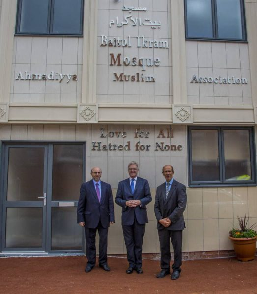 Mr Saleem Ahmed (former President), Sir Edward Garnier and Mr Ather Mirza (External Affairs officer) outside the Bait-ul-Ikram Mosque in Leicester.