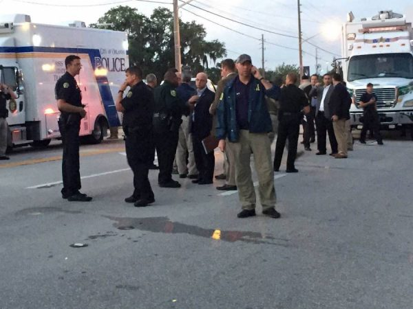 Photo provided by Orlando Police Department shows police officers at the site of the shooting incident in Orlando, Florida, the United States, June 12, 2016. About 50 people were killed and 53 others wounded early Sunday morning in a shooting incident at a gay nightclub in Orlando, Florida, according to Orlando mayor. (