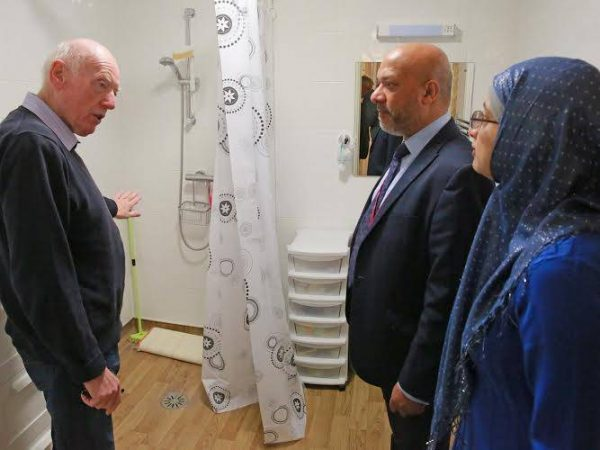 Stratford Court resident Mr Cooper (left) shows Unity chief executive Ali Akbor and Unity board member Shazia Khan around his new property