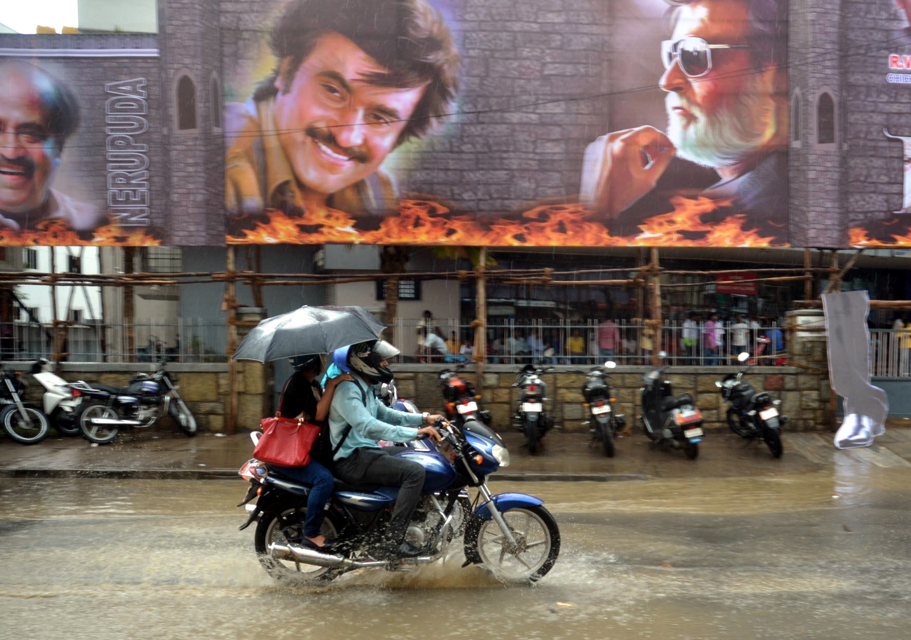 """Bengaluru: Posters of Rajinikanth's upcoming Tamil Film """"Kabali"""" being erected at Urvashi theatre ahead of its release in Bengaluru on July 20, 2016. (Photo: IANS)"""