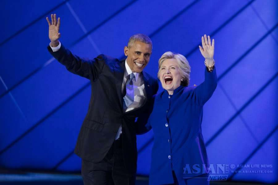 U.S. Democratic Presidential Candidate Hillary Clinton (R) and U.S. President Barack Obama are pictured on the third day of the 2016 Democratic National Convention in Philadelphia, Pennsylvania, the United States