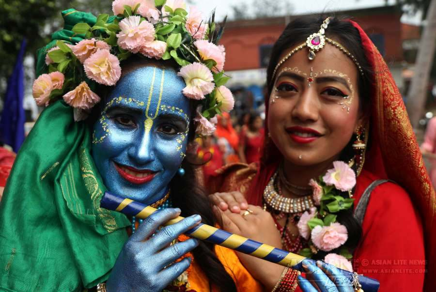 Nepalese devotees dressed up as Lord Krishna and Goddess Radha participate in the procession of the Rath Yatra or Chariot festival in Kathmandu, Nepal on July 28, 2016. Rath Yatra is one of the most important Hindu festivals which involves devotees pulling a chariot of Lord Jagannatha, his brother Balabhadra and sister Subhadra.