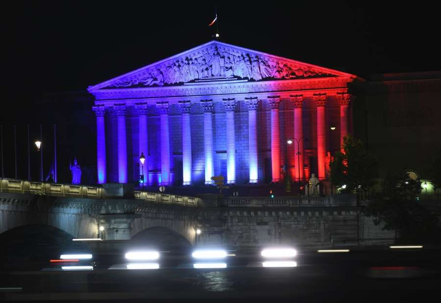 The Palais Bourbon, headquarters of the French National Assembly, is illuminated in the colors of the French national flag to pay tribute to the victims of the Nice terrorist attack, in Paris