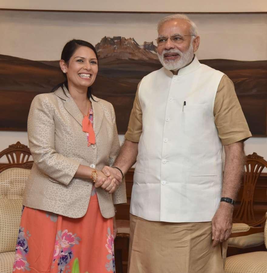 British Secretary of State for International Development Priti Patel with Prime Minister Narendra Modi
