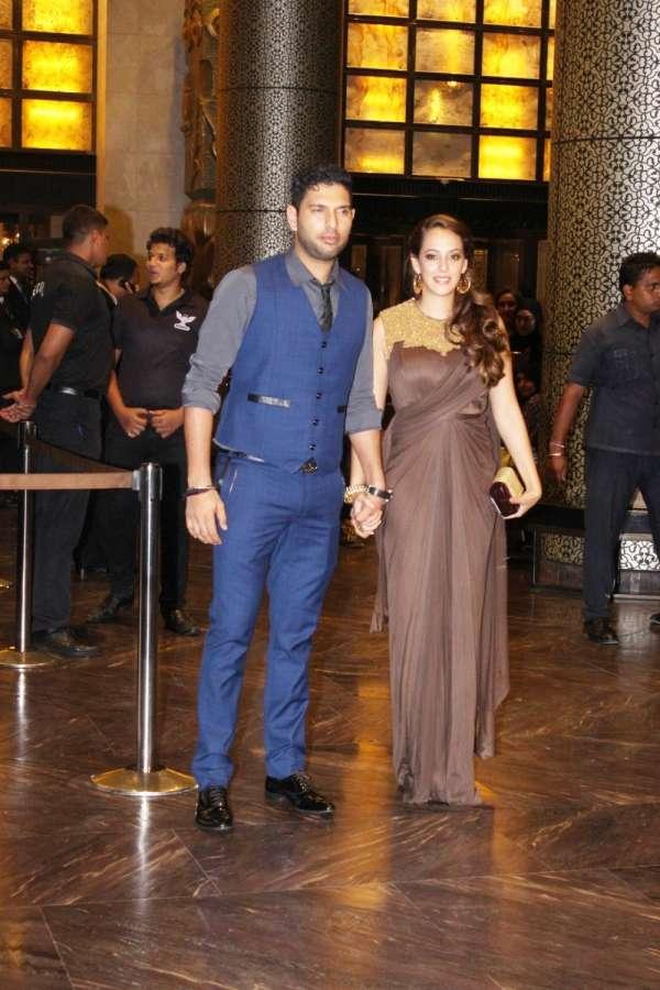 Mumbai: Indian cricketer Yuvraj Singh with fiance actor Hazel Keech during the wedding reception of Preity Zinta and Gene Goodenough in Mumbai, on May 13, 2016. (Photo: IANS)