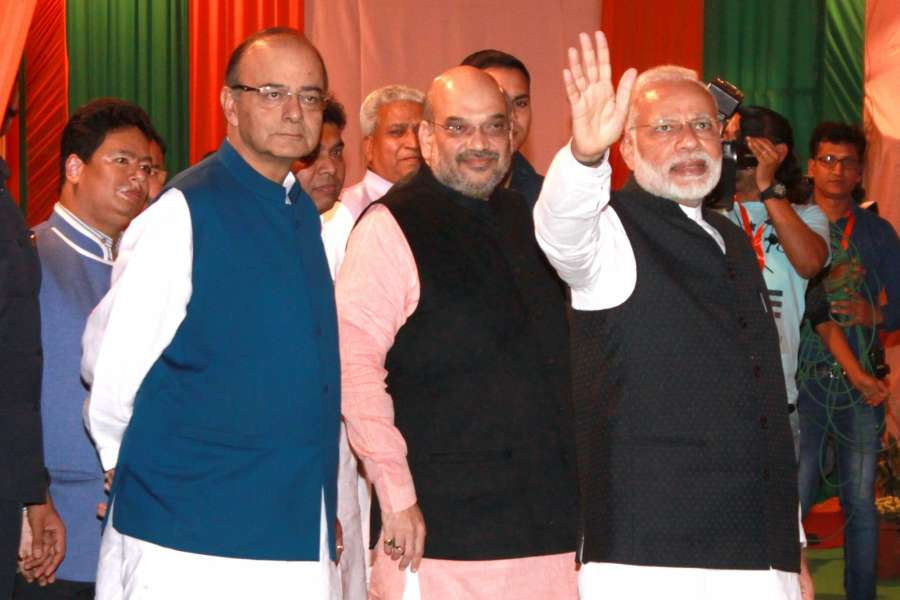 """Prime Minister Narendra Modi, Union Finance Minister Arun Jaitley and BJP chief Amit Shah during """"Diwali Mangal Milan"""" programme at the BJP headquarters in New Delhi"""