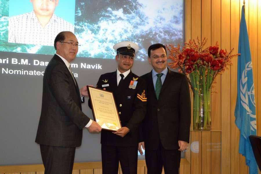 Uttam Navik receiving certificate of commendation