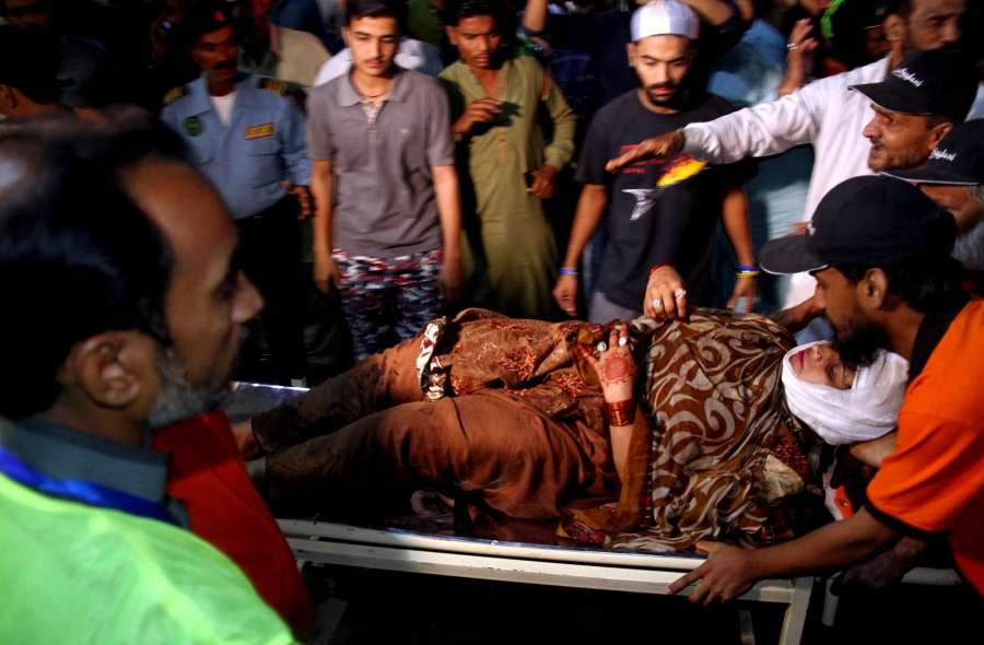 Rescuers transport a female victim to a hospital, following a suicide blast in a shrine in Pakistan's southwest Balochistan province, in Karachi, Pakistan, on Nov. 12, 2016. At least 40 people were killed and over 100 others injured after a suicide blast hit a shrine in Pakistan's southwest Balochistan district on Saturday night, local media and officials said