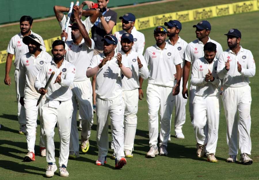 Mumbai: Indian captain Virat Kohli with teammates celebrates after winning the fourth test cricket match between India and England at Wankhede Stadium, Mumbai on Dec. 12, 2016. (Photo: Surjeet Yadav/IANS)