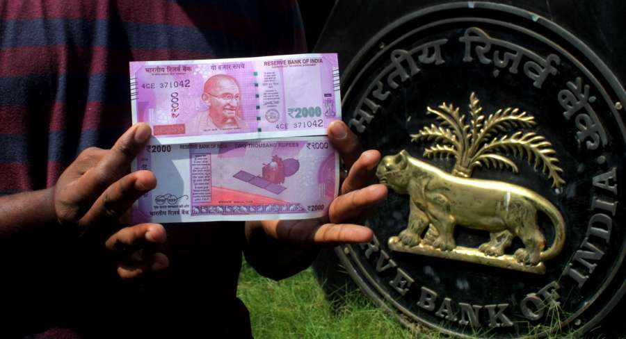 Chennai: People show the new 2000 rupee currency note in Chennai on Nov. 10, 2016. (Photo: IANS)