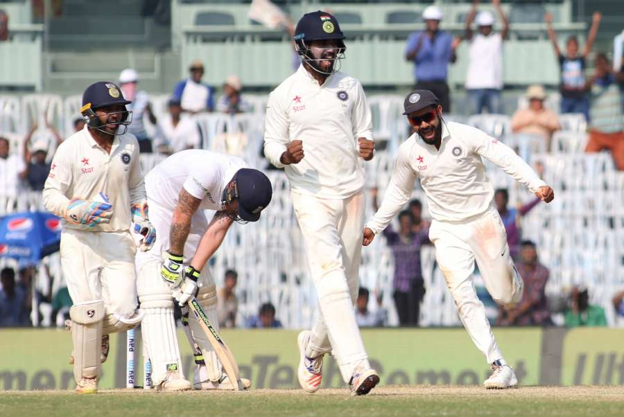 Chennai: India captain Virat Kohli with teammates celebrate fall of England's Ben Stokes wicket on Day 5 of the fifth test match between India and England at M A Chidambaram Stadium in Chennai, on Dec 20, 2016. (Photo: Surjeet Yadav/IANS)