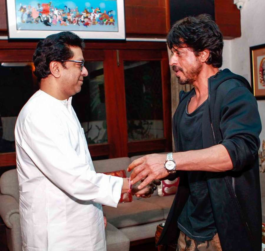 "Mumbai: Actor Shah Rukh Khan meeting MNS Chief Raj Thackeray on the issue of his coming movie release ""Raees"" with Pakistani actress Mahira Khan at Krishnakunj, Dadar in Mumbai on the night of Dec 11, 2016. (Photo: Sandeep Mahankal/IANS)"