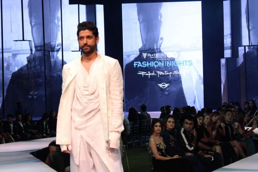 Mumbai: Actor Farhan Akhtar displays the creation of fashion designer Rajesh Pratap Singh during the 2nd edition of Van Heusen + GQ Fashion Nights, in Mumbai, on Dec 4, 2016. (Photo: IANS)