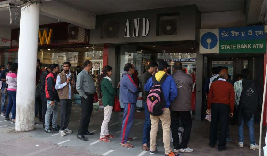 New Delhi: People queue up outside an ATM to withdraw cash in New Delhi on Dec 13, 2016. (Photo: IANS)