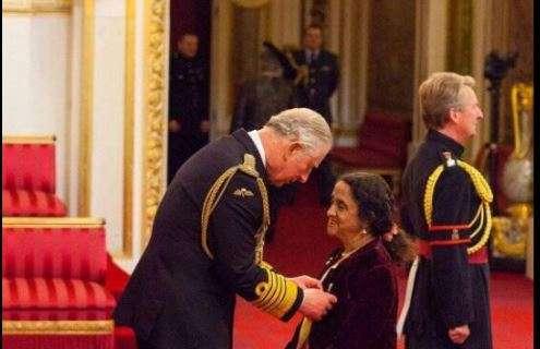 Dr Geetha Upadhyaya accepts OBE from Prince Charles at Buckingham Palace