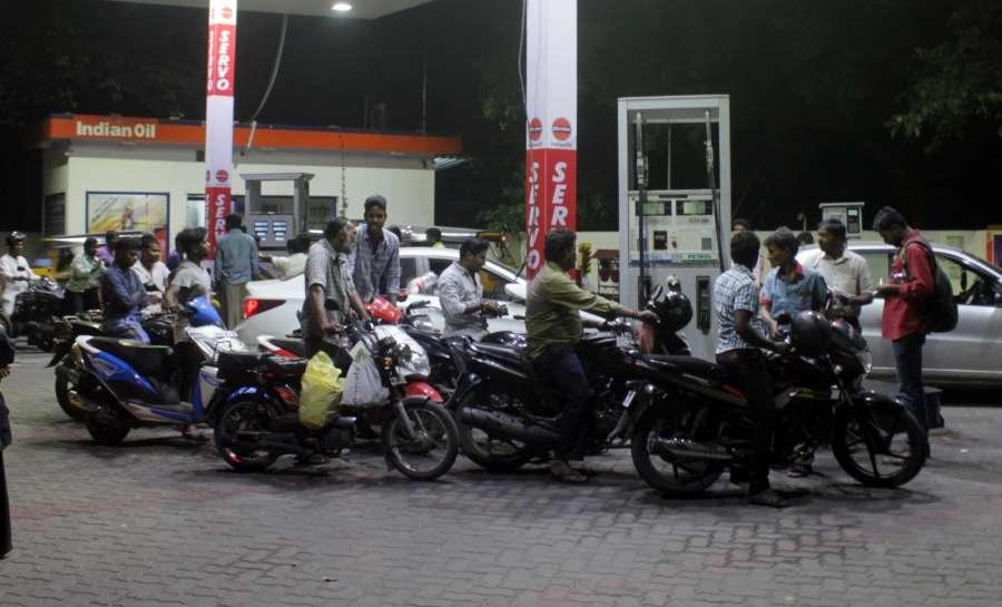 Chennai: People wait at a petrol pump in Chennai on Nov. 8, 2016. (Photo: IANS).
