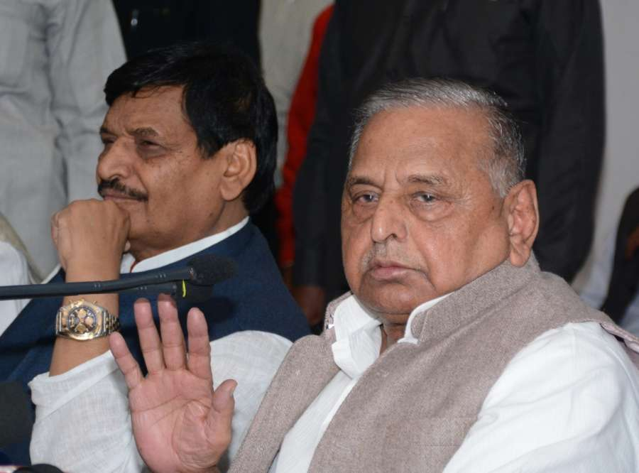 Lucknow: Samajwadi Party (SP) chief Mulayam Singh Yadav during a press conference in Lucknow on Nov 10, 2016. Also seen Samajwadi Party (SP) leader Shivpal Singh Yadav. (Photo: IANS)