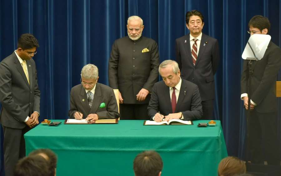 Tokyo: Prime Minister Narendra Modi and Japan's Prime Minister Shinzo Abe witness the exchange of the Civil Nuclear Agreement between India and Japan, at Kantei in Tokyo, Japan on Nov 11, 2016. (Photo: IANS/PIB)