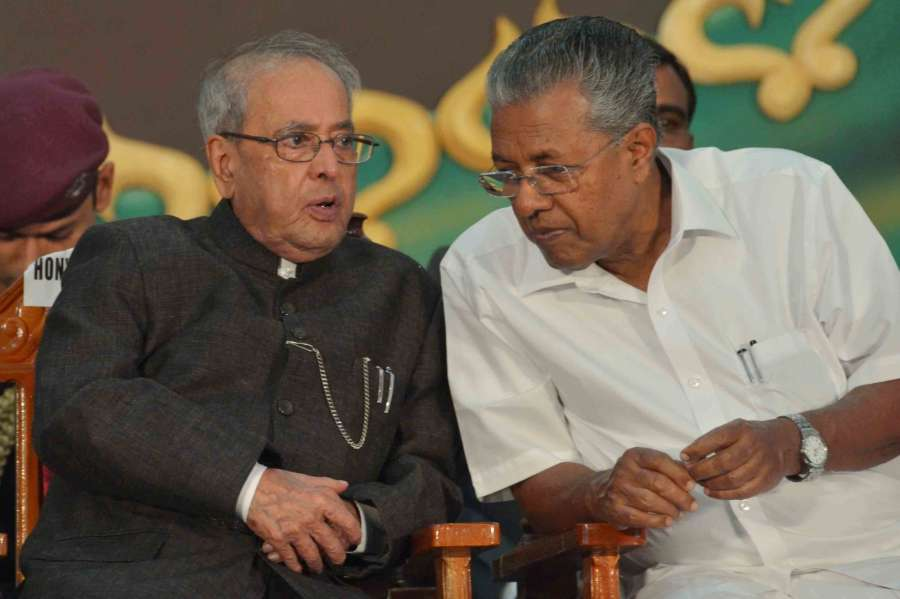 Thiruvanthapuram: President Pranab Mukherjee interacts with Kerala Chief Minister Pinarayi Vijayan during the inauguration of the 77th Session of Indian History Congress in Thiruvanthapuram on Dec 29, 2016. (Photo: IANS/RB)