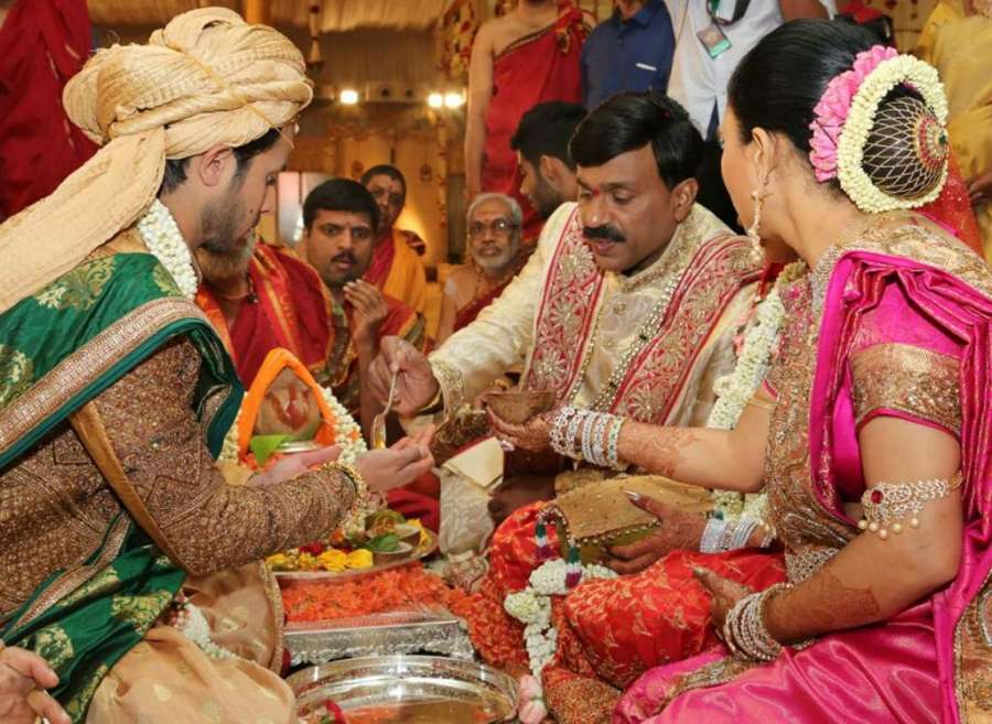 Gali Janardhan Reddi participates in a wedding ritual with his daughter