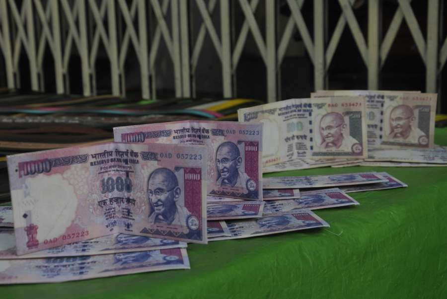 Kolkata: Wallets which look like Indian currency Rs 1000 and 500 notes sell at a Kolkata market on Nov. 9, 2016. (Photo: Kuntal Chakrabarty/IANS)