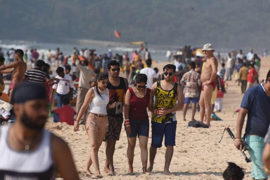Goa: Tourists throng the Calangute beach as the peak tourist season starts in Goa on Nov. 12, 2016. (Photo: IANS)