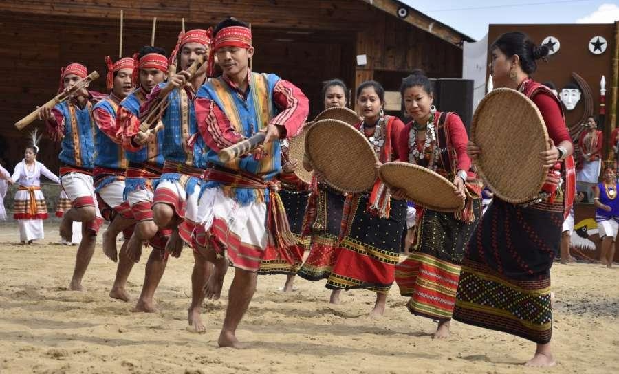 Kisma: Tripura artists perform during Hornbill festival at Kisma village in Nagaland on Dec 1, 2016. (Photo: IANS)